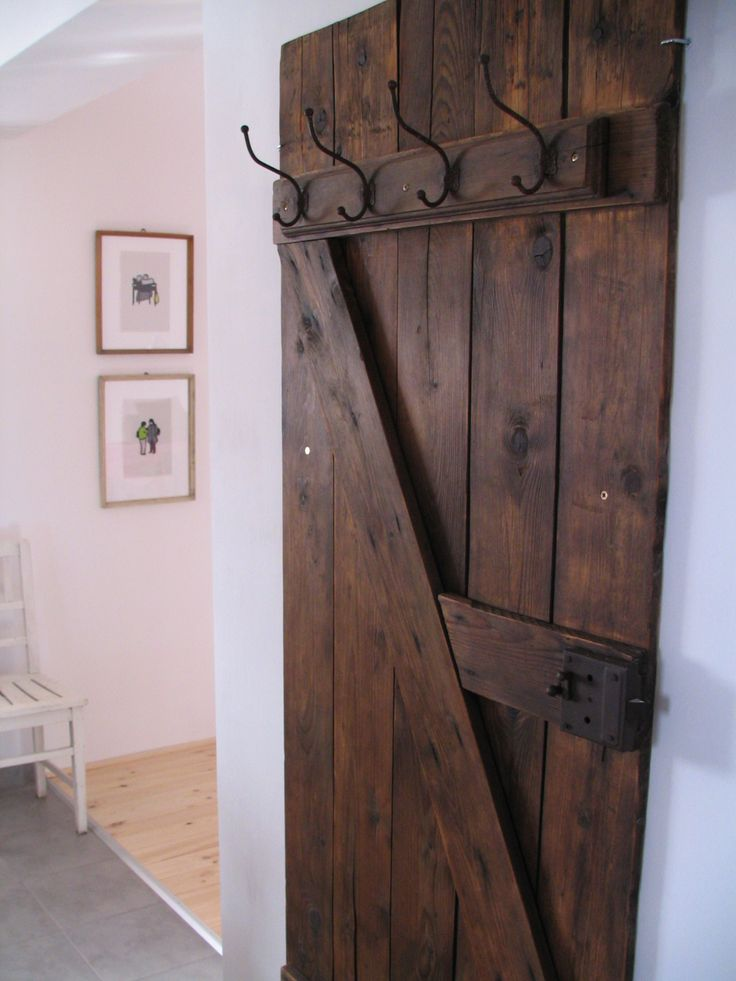 Vintage door coat rack: This would be even better if the door slid to the side and revealed a coat closet inside! Dual storage for minimal wall space in a front foyer.
