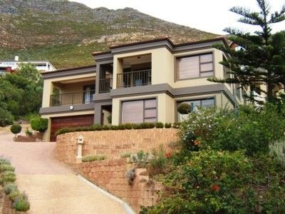 Situated within walking distance of Boulders Beach, this master built home comprises seven spacious bedrooms (3 of which are en-suite), two family bathrooms, guest cloakroom, two gourmet kitchens, two laundry's, indoor braai room for winter entertainment plus staff quarters and double garaging. The reception area's are spacious and include lounge/dining with sea view terrace, formal lounge and a family room.