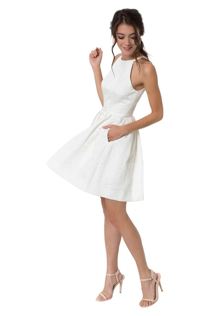 A short white halter top dress with full skirt and pockets for a modern bride. Affordable designer bridesmaid dresses to buy or rent at Vow To Be Chic.