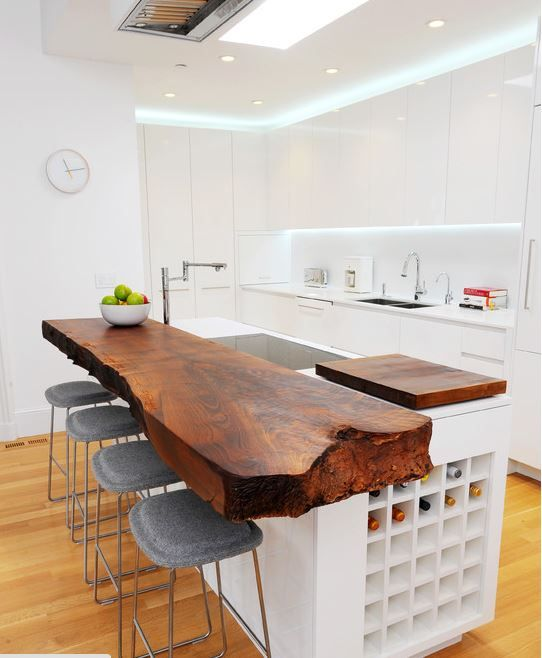 this kitchen doesn't do justice to the slab of wood counter top, mismatched. i love the wood counter.