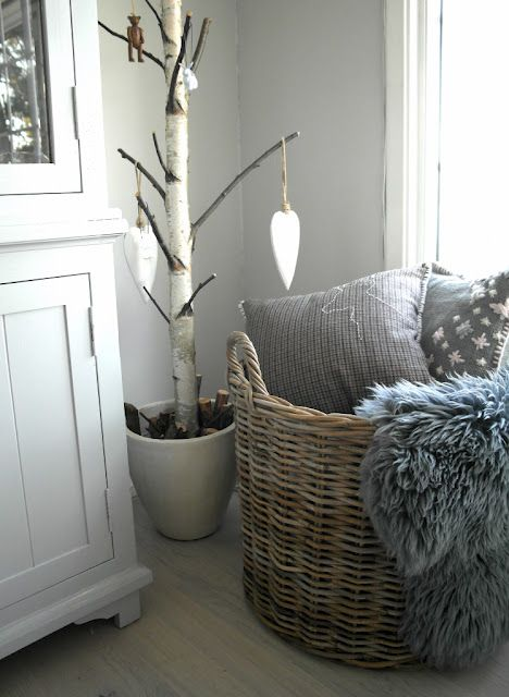 .love the big basket full of pillows and blankets...cozy