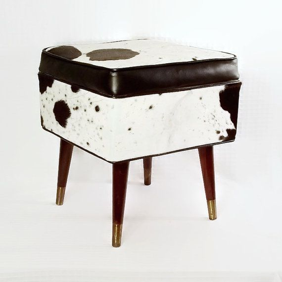 This custom modern cowhide furniture piece is an upcycled vintage sewing stool that is circa late 1960s and has great mid century lines. It has been