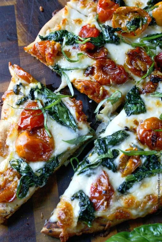 Flatbread makes a fantastic appetizer or light meal. Topped with sweet roasted cherry tomatoes, and spinach will make you keep wanting one more bite.