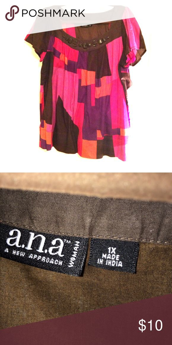 a.n.a. Brand women's short sleeve top Very comfortable short sleeve top with brown jewel type pieces at neck. Pieces are shiney although it didn't show up like that in pic. Very cute with brown slacks or jeans a.n.a Tops Tees - Short Sleeve