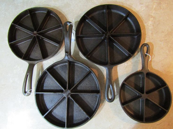 4 pans. China pan, Wagner 8 slice, Birmingham Stove & Range, 8 slice and 6 slice