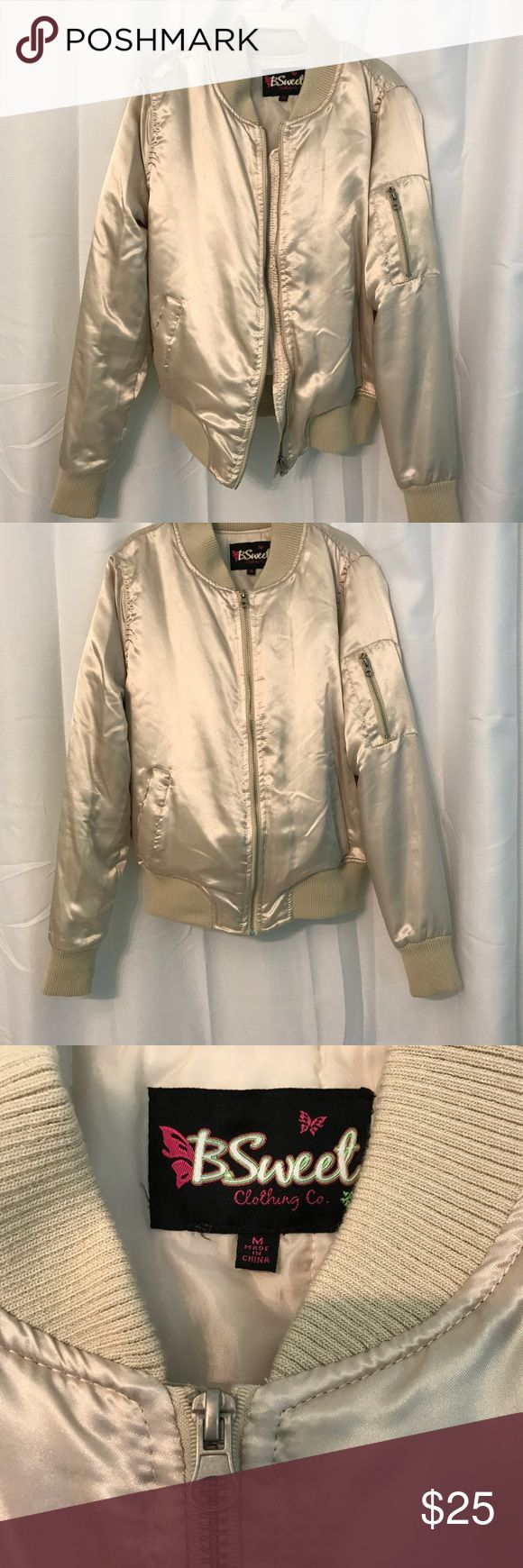 Metallic gold bomber jacket a very stunning light champagne colored bomber jacket from wet seal in size medium. I only wore this once, so it is in great condition. this piece is stylish but will also keep you warm! any questions feel free to ask! Wet Seal Jackets & Coats