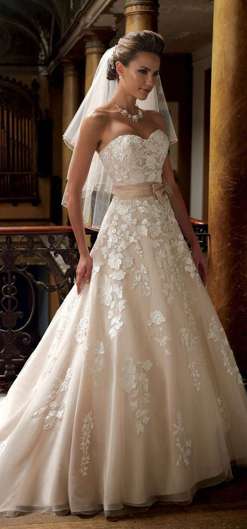 Lovely white strapless weeding dress for brides.