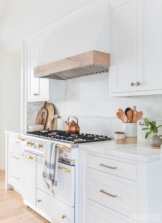 """Kitchen Drawers with brass hardware; """" tons of lower cabinets with drawers;"""" Love simple facade of stove vent, especially wood with white."""