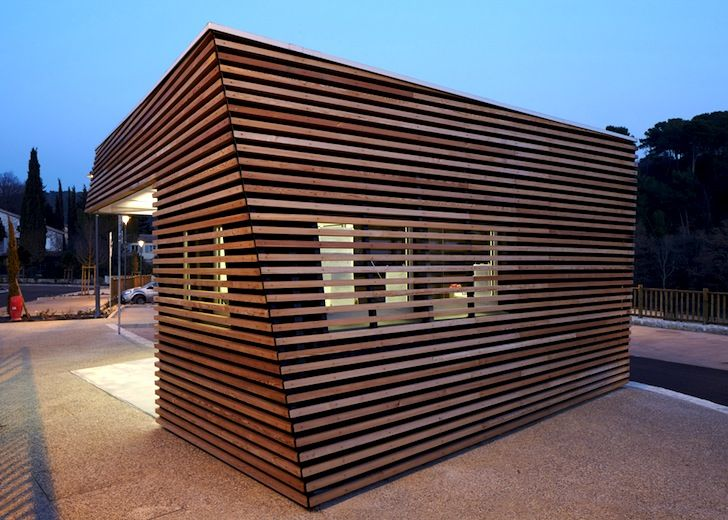Twisted Timber Shell Wraps Around a Parking Attendant's Pavili...  (reminds me of HdM's Signal Building) - T