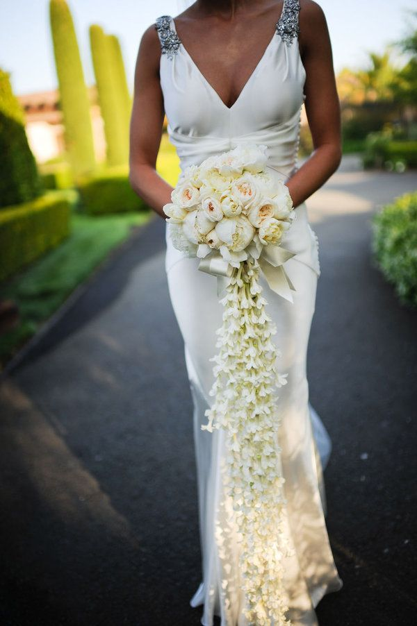 Make a grand entrance with this spectacular, all white, cascading bouquet of roses, garden roses, peonies, and stephanotis.