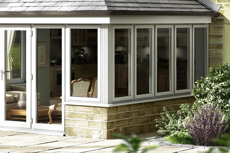Corner view of white aluminium windows on a Tiled Roof Extension