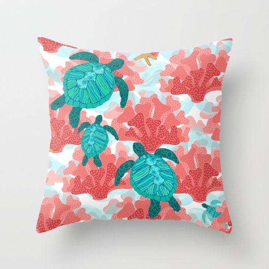 Pretty patterned sea turtles swim peacefully through the coral on a background of aqua watercolor waves.