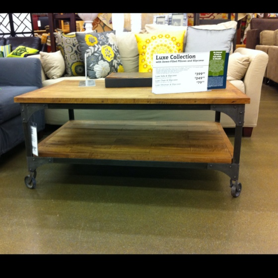 Wood coffee table on metal casters world market $279