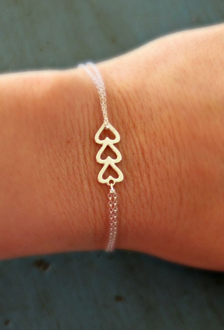 Sterling Silver Heart Bracelet Triple Heart Simple Minimalist Jewelry bridesmaid gifts Sorority Gift. $18.50, via Etsy.