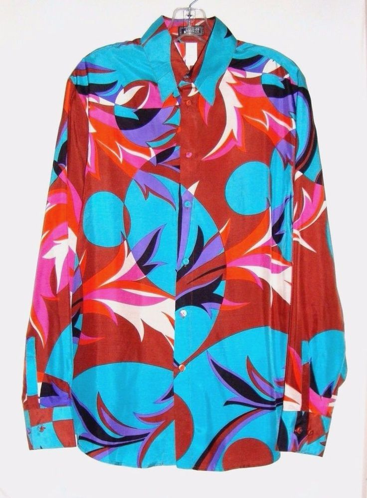 "Details: This is a s tunning Gianni Versace blouse of 100% silk, made in Italy. Bright, beautiful colors in an abstract design, hidden button down. Shoulder to shoulder : 19 1/4"". Sleeve : 25 1/2"". B ack length : 30 1/2"". 