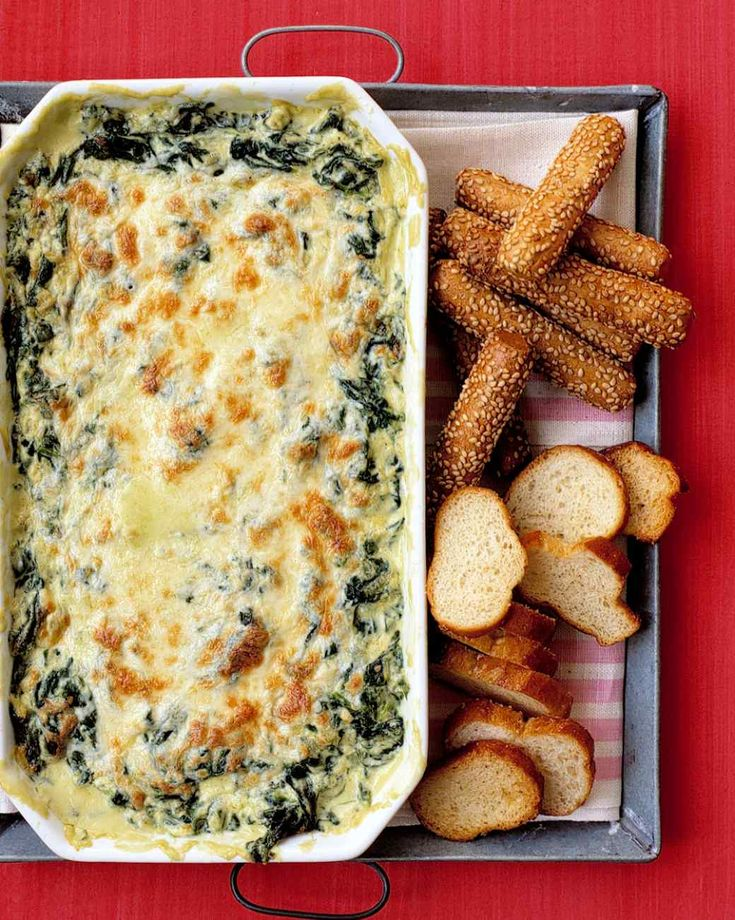 Hot Spinach Dip - Loved this! I added about a cup of artichokes before cooking. After cooking, I put it in hallowed out sourdough bread.