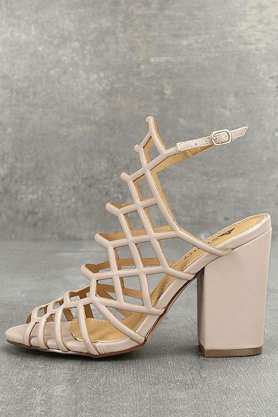 Get the high fashion look you crave with the Hailey Pink Caged Heels! A network of vegan leather straps join atop a peep-toe upper, while an adjustable ankle strap (with gold buckle) completes the look.