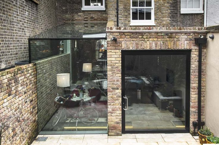 glass side return and large pivot door - notting hill