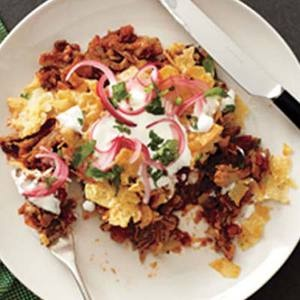 I am super excited about these Pork Chilaquiles. #delicious | http://www.rachaelraymag.com/Recipes/rachael-ray-magazine-recipe-search/dinner-recipes/pork-chilaquiles
