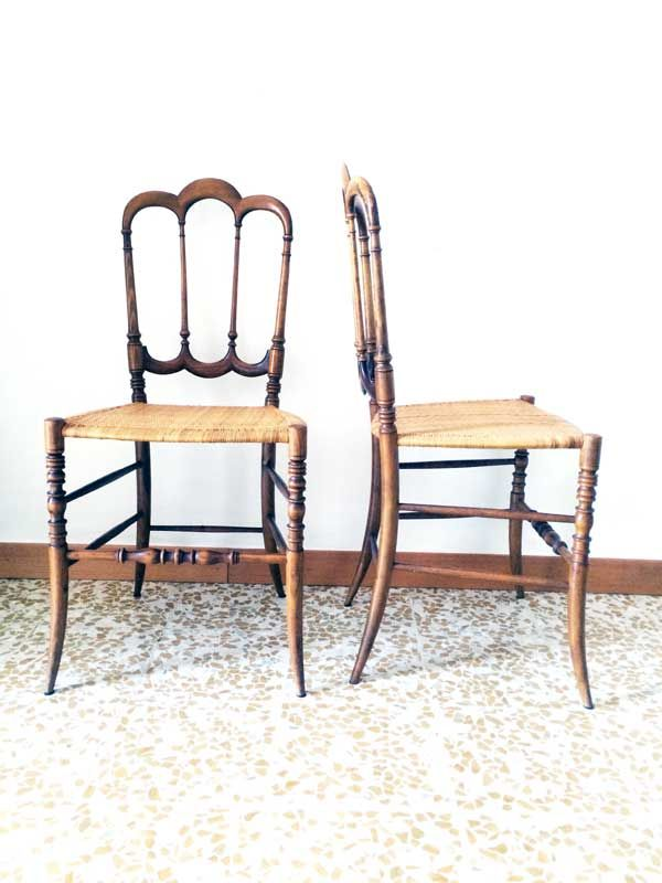 """tre archi bassa"" is the name of this very rare and marvellous pair of Chiavari chairs. Seat and structure in perfect conditions. Signed by Fratelli Levaggi ® ////////////////////////////////////////////// Coppia di sedie di chiavari mod. ""tre archi bassa"" marchiate Fratelli Levaggi. Struttura in noce ed impaglio in ottime condizioni."