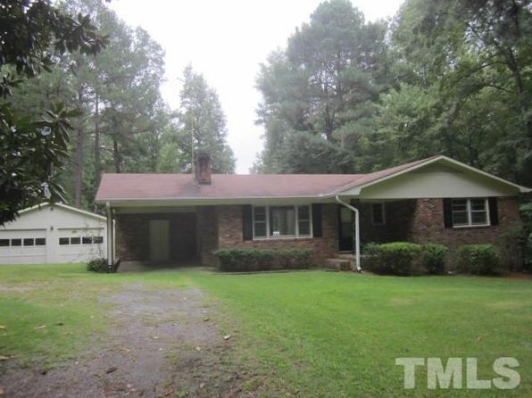 For sale: $239,900. Classic brick ranch with 1 attached carport plus a large detached garage. Garage offers tremendous work space. Lovely rural setting with over 13+ acre lot!!! Long drive leads you to the house so nicely setback off the road. Porch and deck help you enjoy the outdoors. Largely wooded lot plus a small pond. The house has been nicely repaired and ready for new owner. Master suite is good size. Living room has a grand masonry fireplace. Don't miss this rare opportunity. Cal...