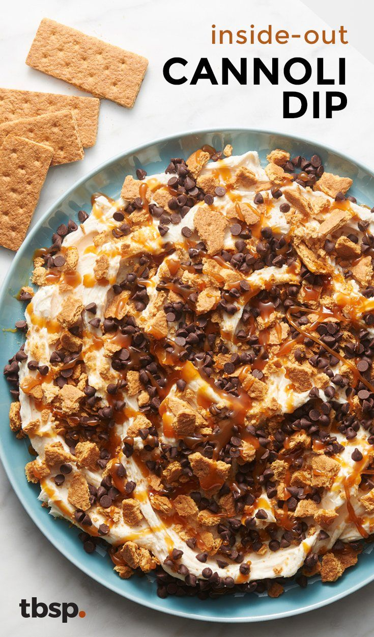 This easy, pretty dip is a feast for the eyes — and for the mouth. Inspired by the classic Italian dessert, it starts with a sweet cinnamon-orange cream cheese, then gets heaped with layers of chocolate chips, caramel and crushed graham crackers. Holy cannoli, it's good! (Sorry, we had to.)