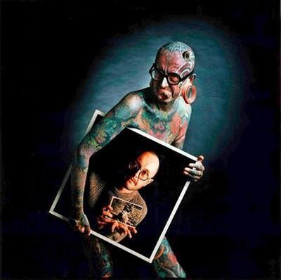 A tattooed journalist Etienne Dumont lensed by Francis Traunig (http://www.traunig.ch/)