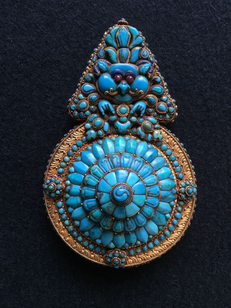 Ear ornament for official in Tibet. Gold, turquoise, rubies. 17th-19th c AD. Private collection