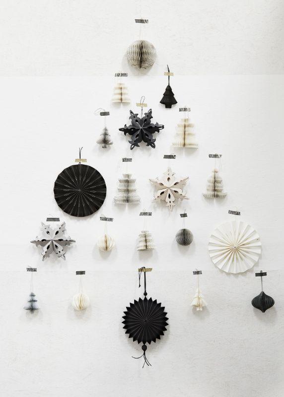 Stars, snowflakes, & trees create a wall-mounted Christmas tree!