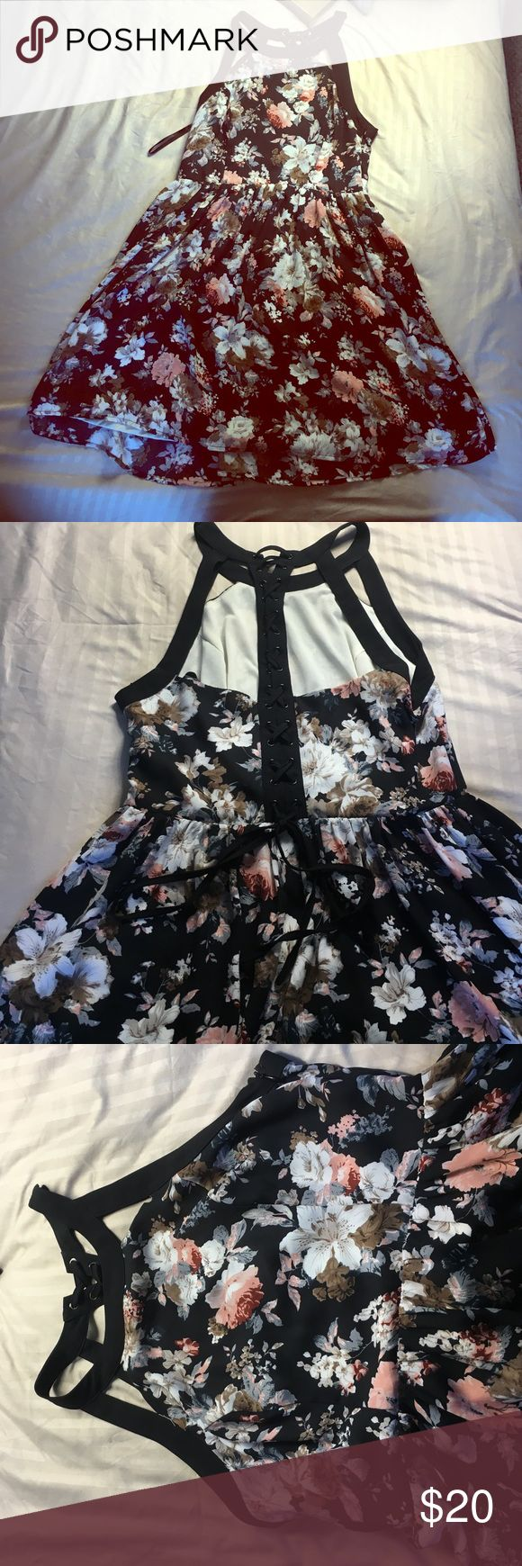 Floral Winter Dress with Black Lace up Straps Warn once. Feminine dress with a little attitude. Chiffon material and super cute for fall. Bought from Bloomingdales. True to size and comfortable. Ark & Co Dresses Midi