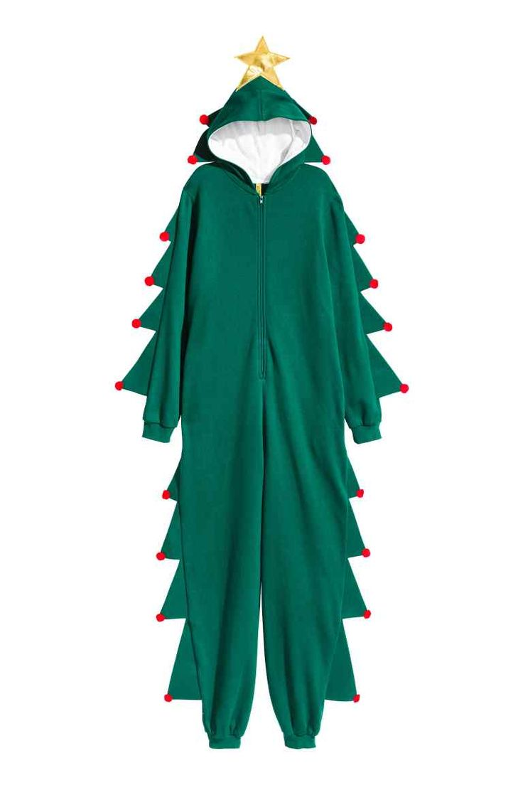 Disfraz de árbol de Navidad: Disfraz de árbol de Navidad en tejido de punto con cremallera delante, bolsillos al bies, y puños y bajos en punto elástico de canalé. Capucha forrada con estrella cosida en la parte superior y puntas con aplicaciones redondas que continúan en manos y piernas. Tejido cepillado en el interior.