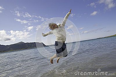 Little girl jumping on Lofoten beach