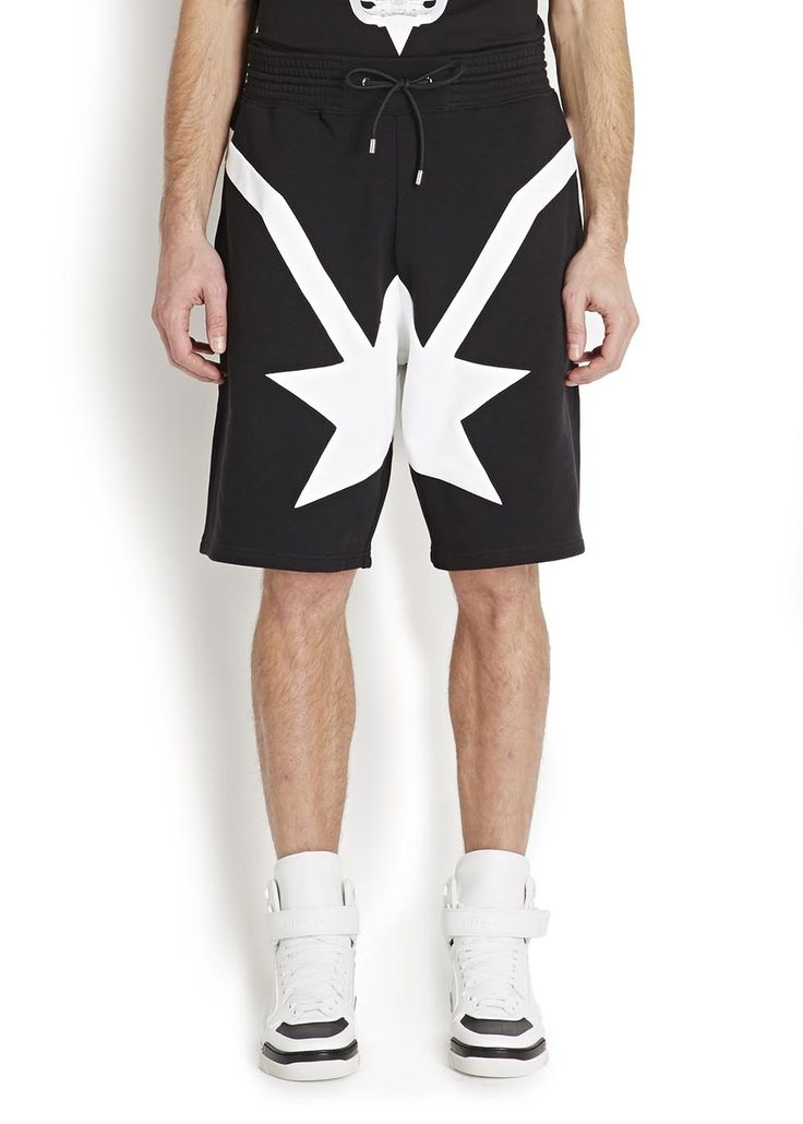 """Givenchy black cotton jersey shorts White stars and stripe print, ties at drawsting waist, side slant pockets, back pocket Pull on 100% cotton Machine wash Length waist to hem: 22 inches/ 55cm Midweight Relaxed style This style runs true to size Model is 6'0""""/ 183cm and wears a size medium RRP: £490.00 (harvey nichols)"""