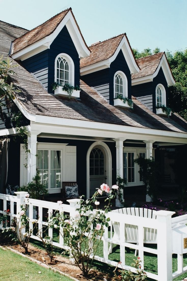 Love the color scheme: white, gray, dark blue gray and light pink mixed with the dormers and planter boxes!