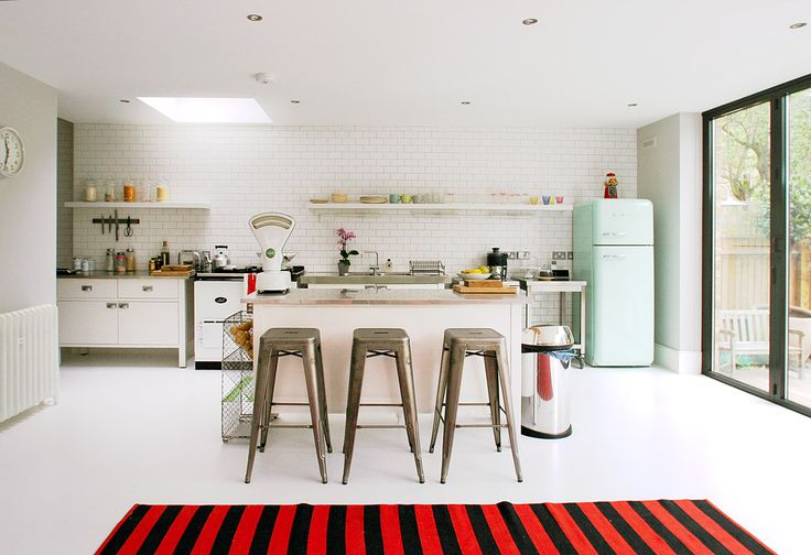 Great subway tiles, open shelving, industrial counter-tops, and SMEG fridge