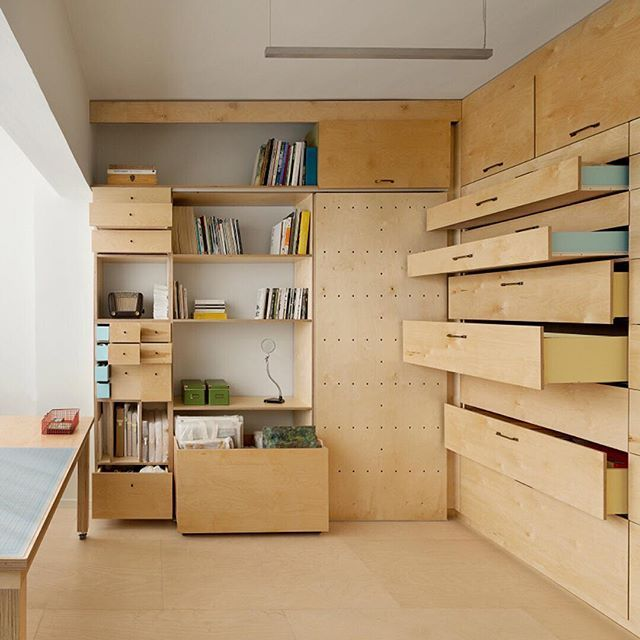 Two desks, pegboard display walls and a folding bed are contained inside this 15-square metre artist's studio built by Israeli architect Ranaan Stern.  The unusual set up was designed to accommodate living and working spaces, as well as display areas for a collection of specific objects. We're rounding up some of our favourite space-saving solutions from our archives, see more on dezeen.com/interiors #interiordesign #studio #Israel  Photograph by Gidon Levin.