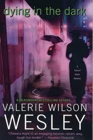 dying in the dark by Valerie Wilson Wesley  http://www.valeriewilsonwesley.com/mysteries
