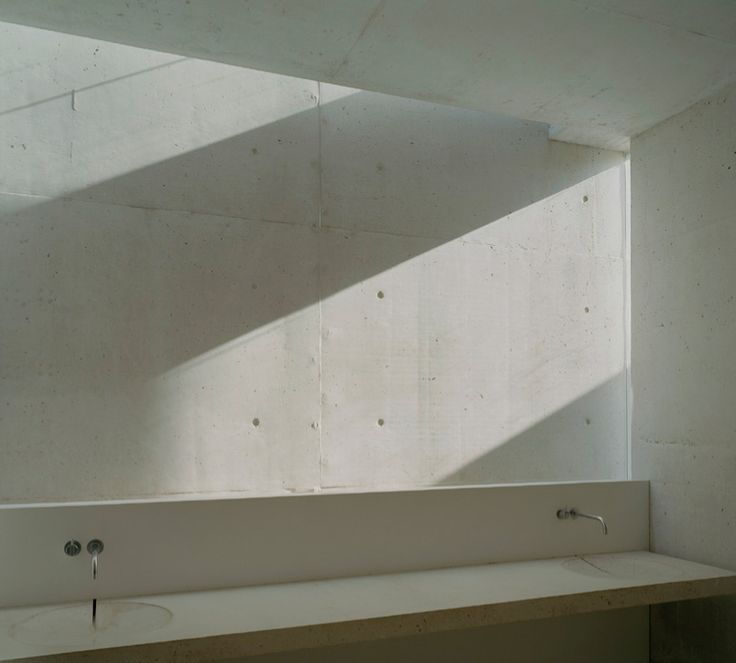 Sunlight on smooth conrete. Holy Rosary Church complex by Trahan Architects.