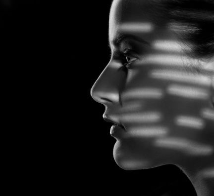 woman's face in shadow