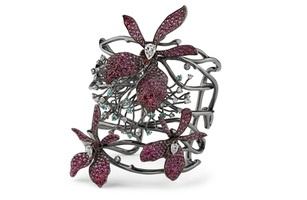 Arunashi's Wild Flower cuff is made in titanium with diamonds, spinel, paraiba and sapphires ($86,400) and is a one-of-a-kind piece, a trend seen at Couture and in the market this year.