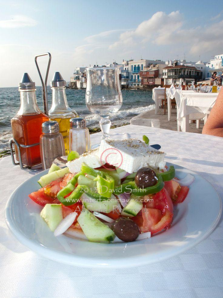 Greek Salad and white wine in Little Venice in Mykonos, Greece