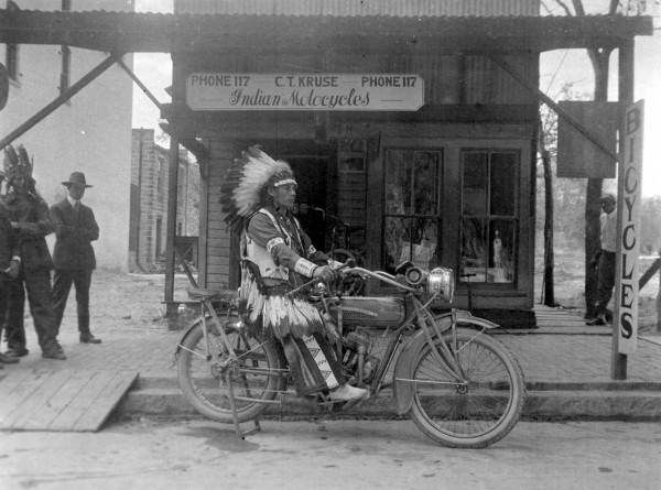 Florida Memory - Indian on an Indian motorcycle in front of C.T. Kruse's motorcycle shop