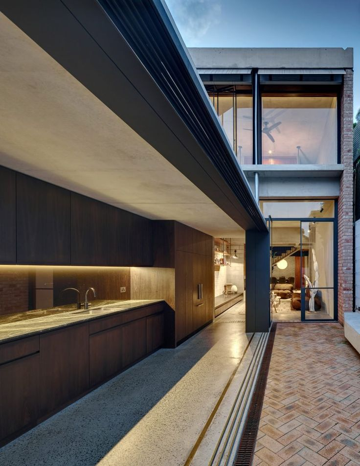 Annandale House, a family residence named after its suburban location, occupies a long and narrow site, which measures five metres wide and steps across three levels.