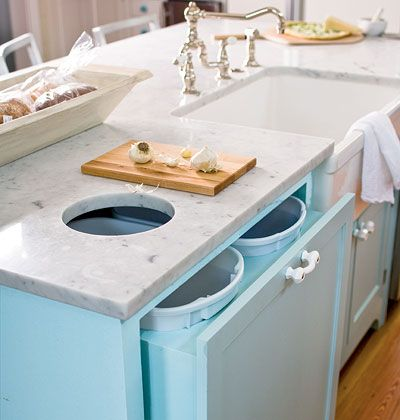 A countertop cut-out and trash cabinet with spaces for multiple cans makes dividing effortless. Myhomeideas.com