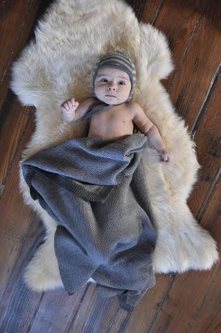 babies + lambskin = a dream!  They last forever and are machine washable.  Keeps baby cool in the summer and warm in the winter.
