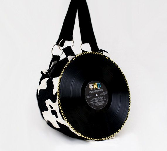 Shoulder bag with double strap, handmade with cotton fancy cow and black faux fur. On the front side vinyl of John Robinson