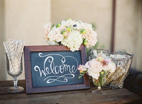 Chalkboard Welcome Sign with Blush Flowers | Blueberry Photography | http://heyweddinglady.com/sparkling-rustic-glam-vineyard-wedding/