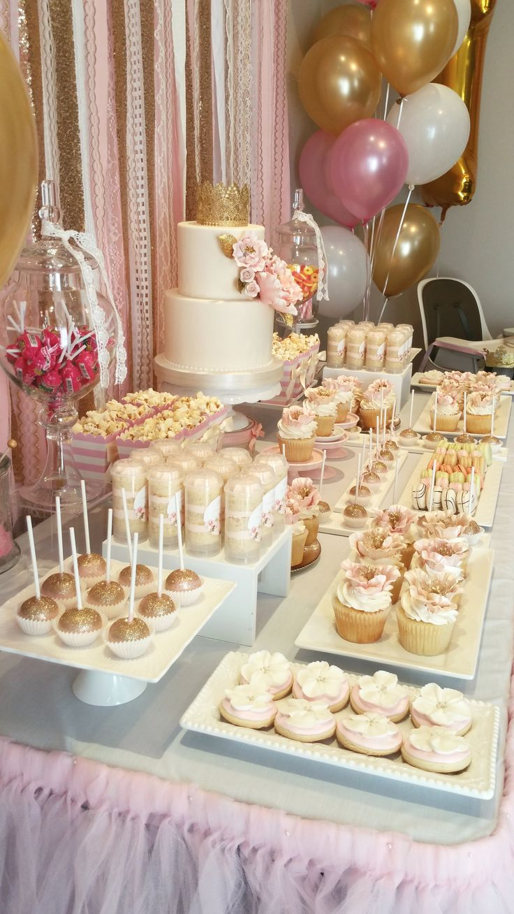 Pink and gold first birthday Bobbette & Belle sweet table cupcakes, cake pops, push pops, macarons, popcorn, floral cookies and candies