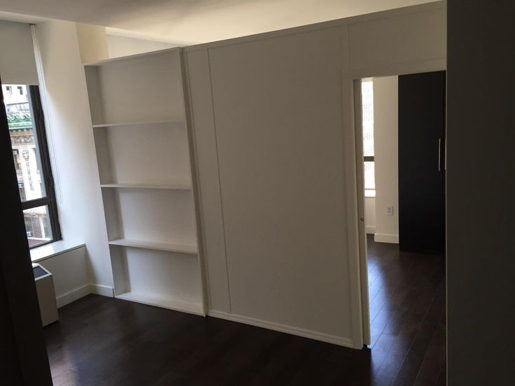 Custom room divider with bookcase and single pocket door. Call us for all  your custom - 34 Best Images About Custom Bookcase Walls On Pinterest