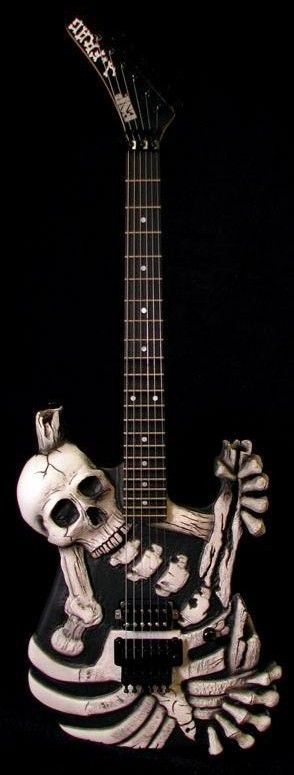 "George Lynch's J.  FROG Skull n' Bones ESP...the original was not an ESP, it was hand-carved by Johnny ""J. Frog"" Garcia, a horror movie make-up artist in Hollywood."